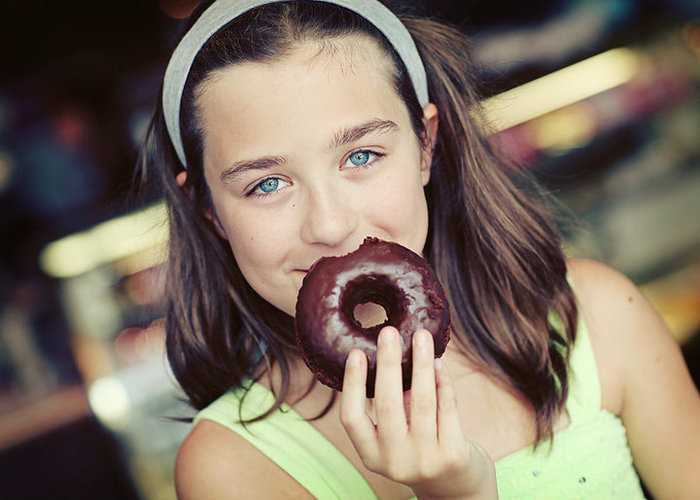 One of our favorite customers enjoying a SFB Chocolate Donut...
