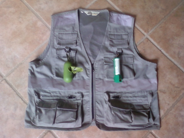 Prototype of front of vest.  I equipped my prototype with a dog waste bag canister and mace.  I carry my cell phone in the front pocket, dog treats, and my ID.