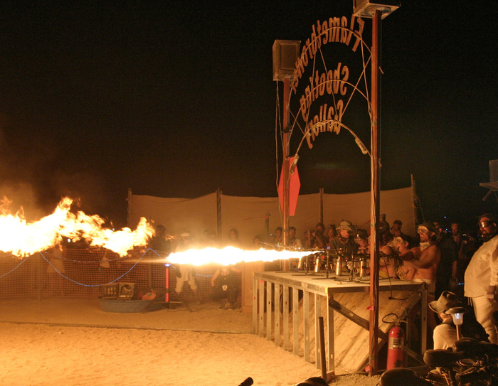 "Flamethrower Shooting Gallery provides a flaming twist on ""County Fair"" style shooting galleries. (Burning Man 2008 + 2009)"