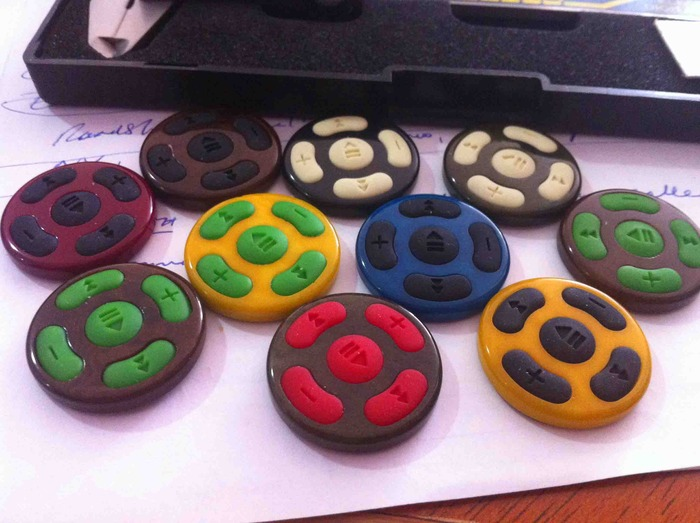 Tooled rubber button units sitting in their natural Tagua nut bezels
