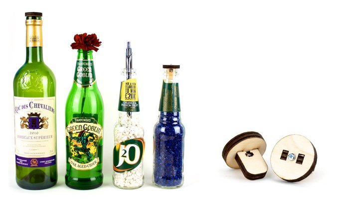 Different size & style bottles — some filled with coloured aquarium pebbles, one used as a vase, another a pen holder, and shown with the matching wood bottle stoppers