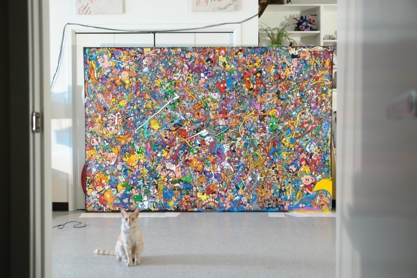 In 2009 I made the Comicosm, a 9' by 6' oil painting with 1,546 characters. That's my cat JFK, the Jerk Face Kitty in front.