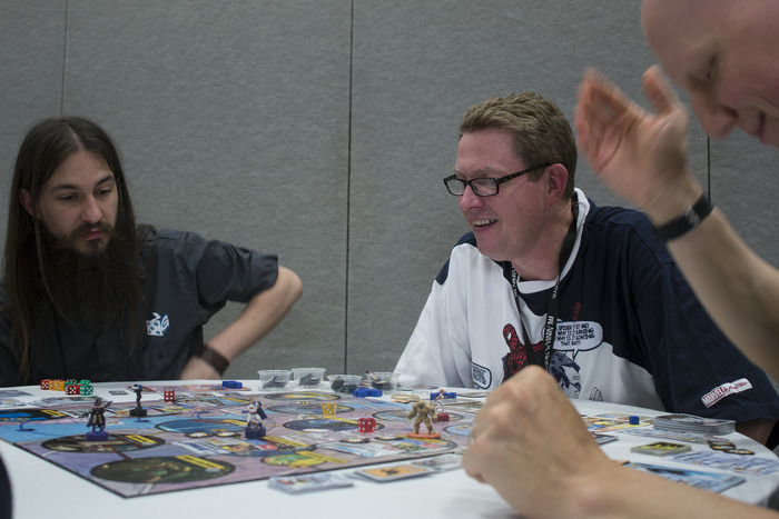 Chris Badell of Greater than Games and Designer Richard Launius playtest an alpha  prototype.