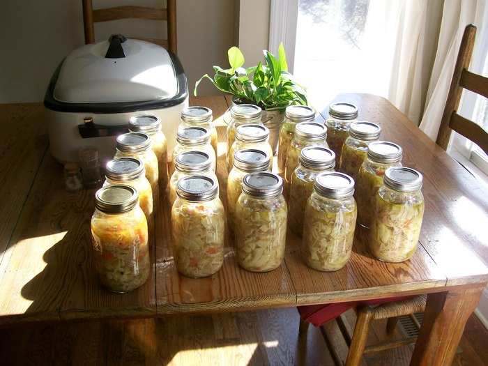 Mason jars full of delicious homemade chicken noodle soup, ready for delivery.