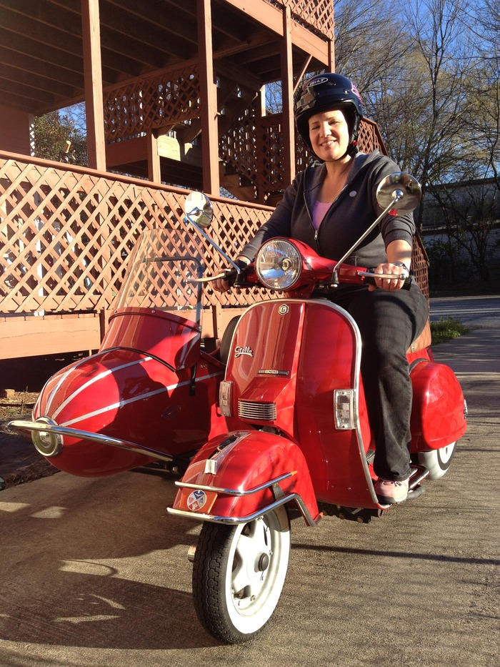 Soup Mama on her Stella scooter + sidecar