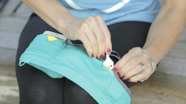 Side pockets for stowing keys, gels, lip balm, or other small items.