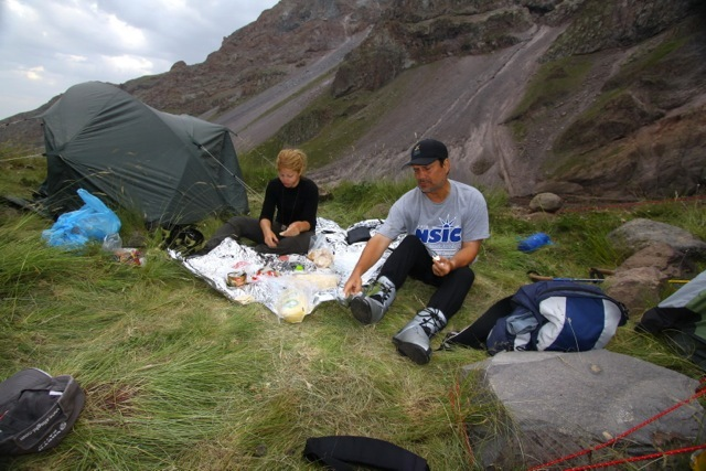 Eating at base camp after a 12-hour day of climbing