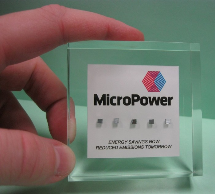 "Five MicroPower Chips in a solid Acrylic Plaque (2.5"" x 2.5"" x 0.9""). Inscription will read ""Energy Savings Now. Reduced Emissions Tomorrow. A Safer Planet For Our Children""."