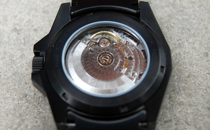 View of the Tessera movement through the caseback with rhodium perlage finish