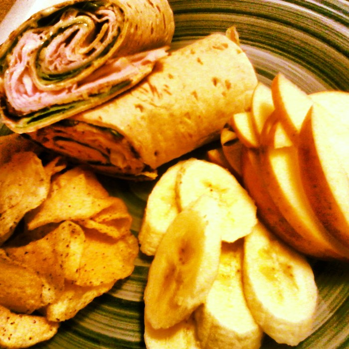 Herbed Turkey, Poppy Seed Dressing, Arugula in a Herbed Flat bread served with fresh apples, banana's and house made chips