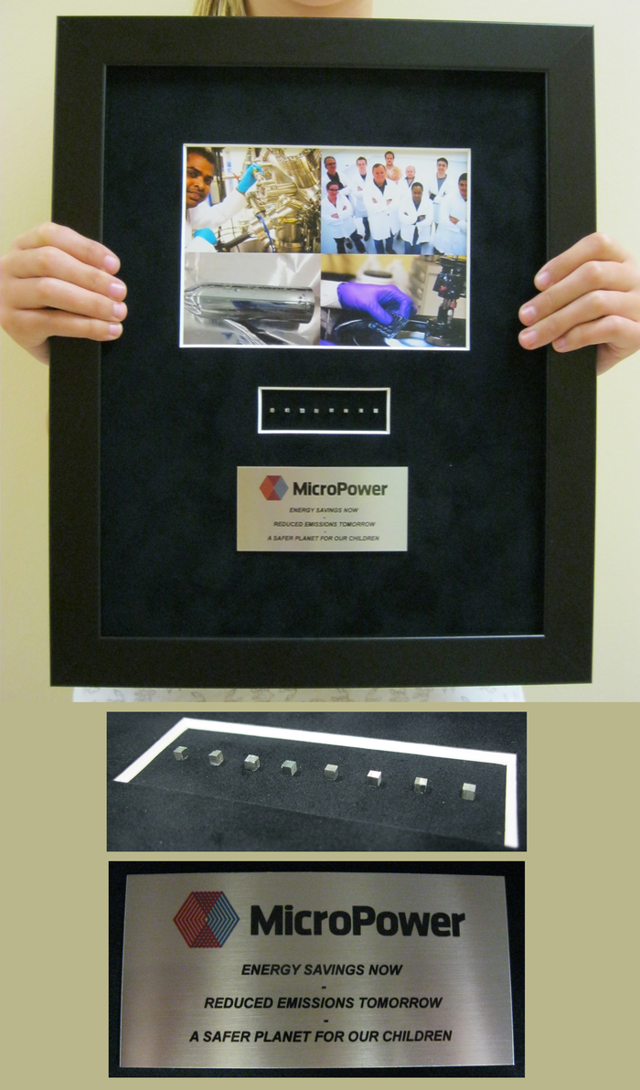 "Eight MicroPower Chips mounted in a Picture Display (14"" x 11"").  Insert  photos are close-up shots of MicroPower Chips and metal inscription plate with ""Energy Savings Now. Reduced Emissions Tomorrow. A Safer Planet For Our Children""."