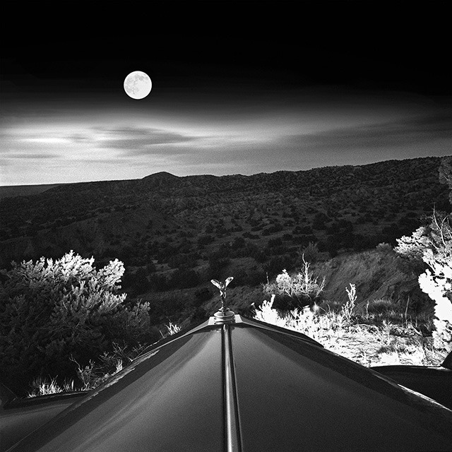 "$1,000 – ""Moonrise Over Rolls Royce"" by Elliott McDowell – photograph, signed, framed, 12""x12"" inches"