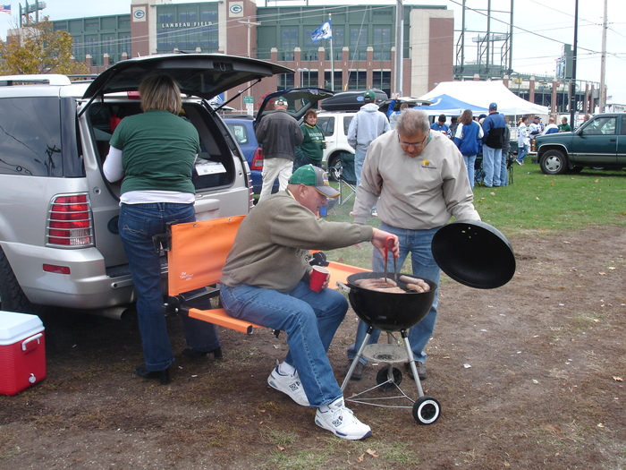 "Getting their ""grill on"" at Lambeau, with the Take-A-Seat."