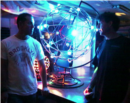 "Scott London and Yarrow Mazzetti getting excited about ""small"" scale prototype of the Desert Disco Ball."