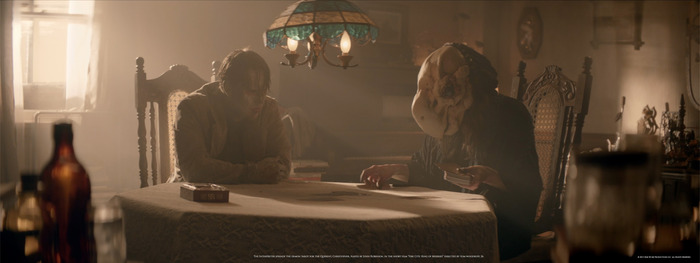 "The Interpreter spreads the cards for the querent Christopher, played by John Robinson, in the short film ""Fire City: King of Miseries"" directed by Tom Woodruff, Jr."