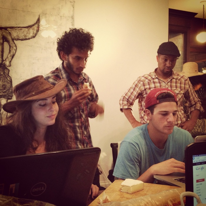 Lexxi, Milo, JP, and Roland hard at work at a production meeting.