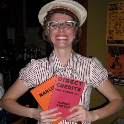 Producer Susan wearing the Direct Credits Society hat and holding Direct Credits and Manlife.