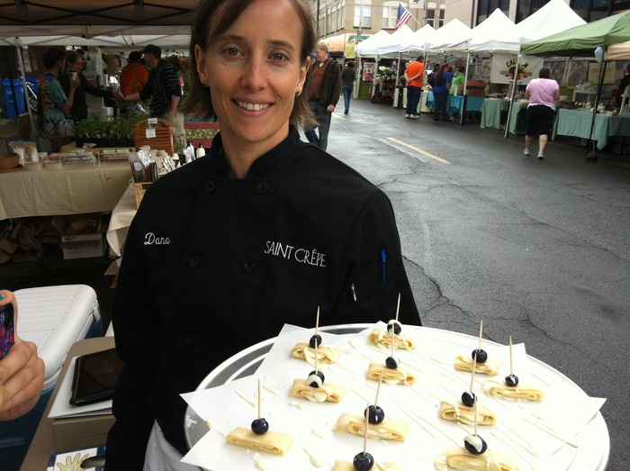 Giving tasty samples at the farmer's market.