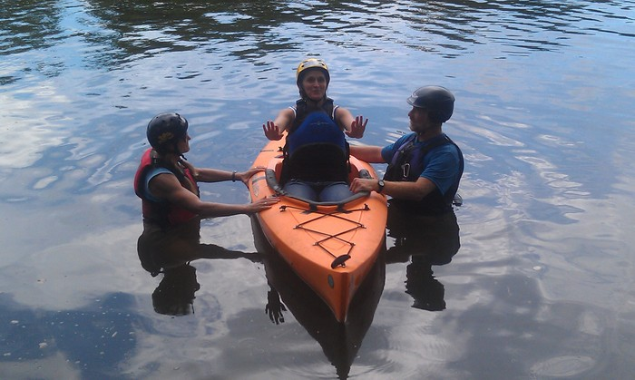 Terri Allards gets a kayaking lesson from Wintergreen Adaptive Sports