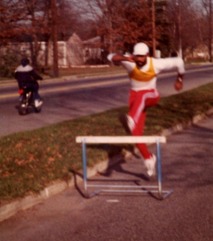Champions run anywhere! Greg Foster training on the street in front of our house.