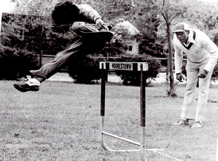 Me hurdling at age 10 under the watchful eye of my dad.