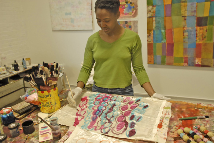 In Studio: Handpainting on silk. Many of my designs are hand drawn.