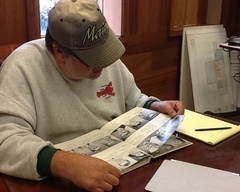 Scott Gabrielson researching former students in the Woonsocket Library