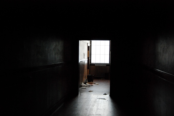 Dark hallway connecting two sections of the school.