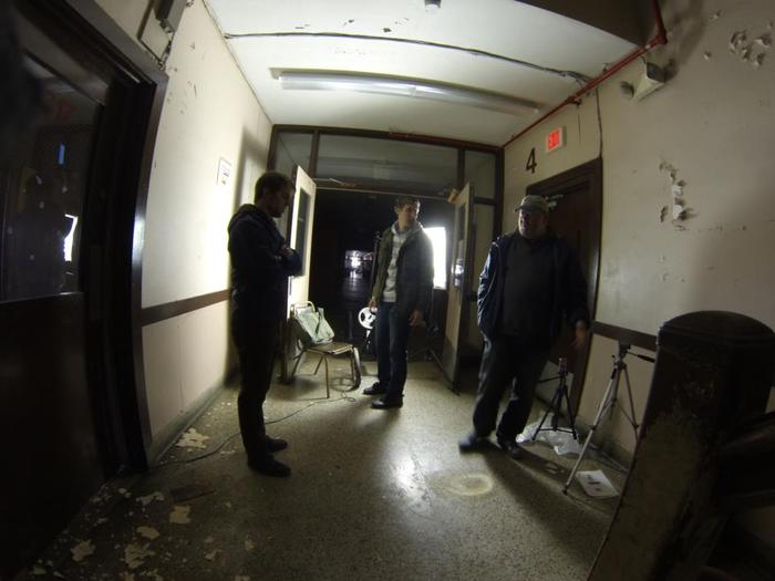 Cameraman Corey Brunelle, Jason Allard, and Scott Gabrielson discuss a shot in one of the school's dark hallways