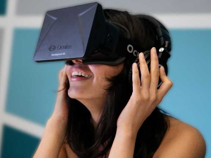 Here's a lady enjoying the Oculus Rift