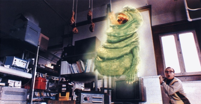 Louis tries to catch Slimer as a way of proving himself capable as a Ghostbuster (via fried chicken).
