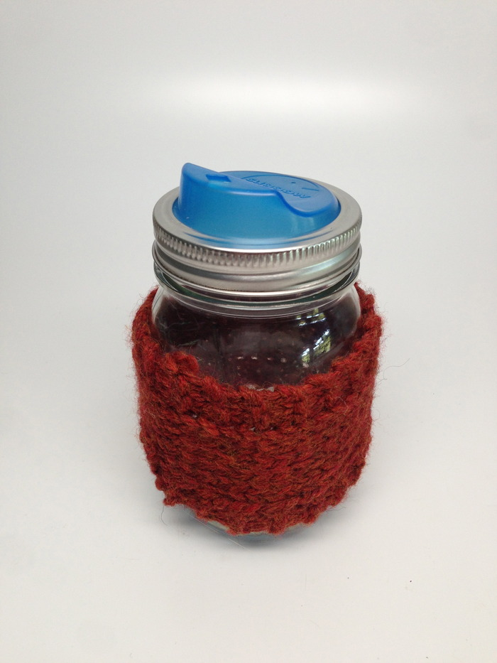 Hand knit Mason Jar koozie. Color will vary. [Blue lid is known as a Cuppow and is not included. You can get yours at Cuppow.com]