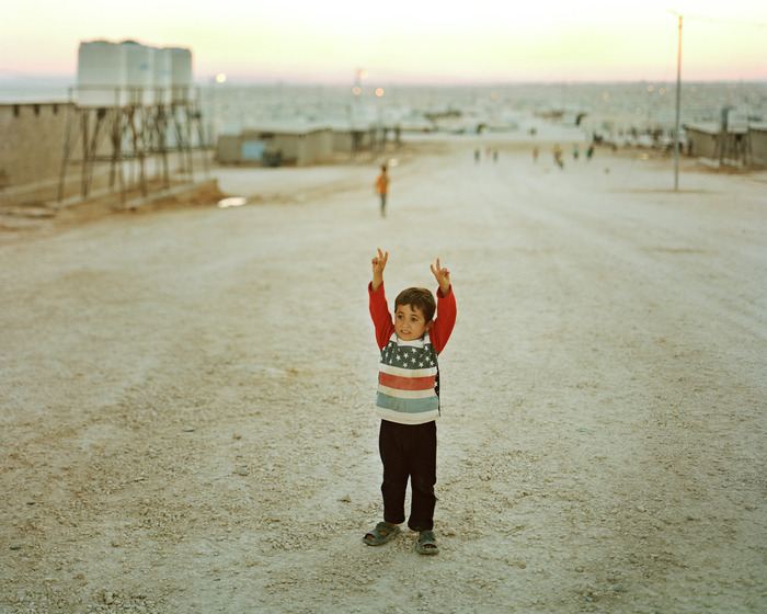 Mohammad Ghazi Al Kaderi, 5 from Dara'a, Syria, give the peace in Zaatari refugee camp.