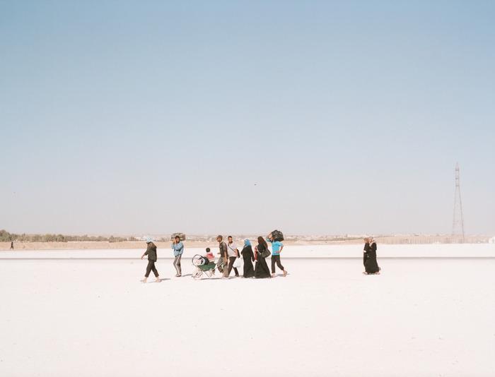 People walk along the outskirts of Zaatari refugee camp in Jordan.