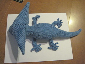 A prehistoric amphibian called a diplocaulus, knitted by me
