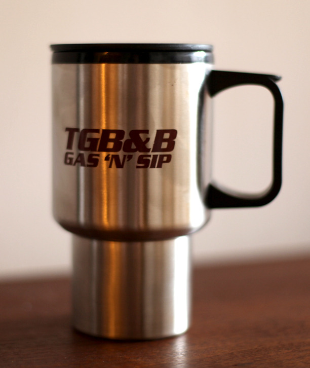 Prop travel mug. Yes, that does say TGB&B Gas & Sip. It will make a lot more sense once you see the film. These were only given to cast and crew. Only 5 available.