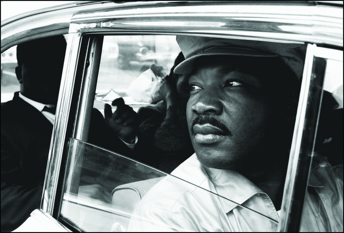 Martin Luther King JR. with his brother, A.D. King, leaving the airport to rejoin the Selma to Montgomery marchers. Montgomery County - 24 March 1965