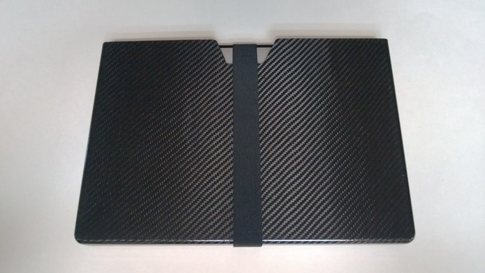 The case with the included removable elastic band. Without it, the laptop takes over 2 seconds to slide out when fully inverted due to friction from the foam's precise fit.
