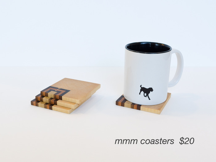 Set of 4 wood coasters featuring the MMM logo. (Mug not included)