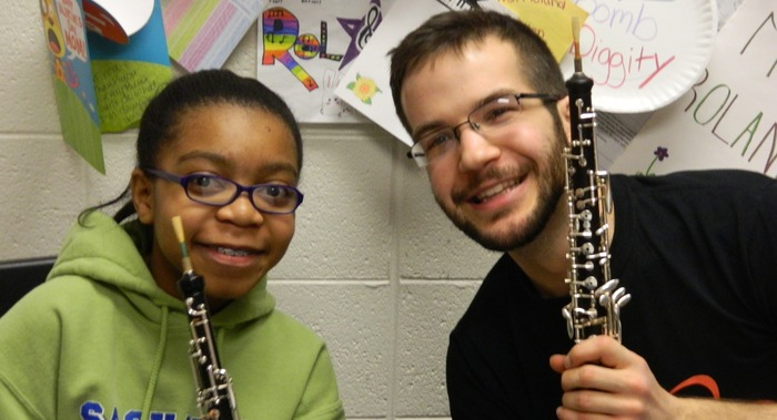 Tim with an aspiring oboist at Sashabaw Middle School