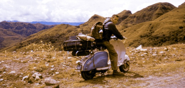 The Andes offer no end of majestic backdrops for photographs of intrepid adventurers on their noble scooter. (Colombia, March 1960)