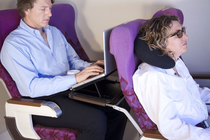 Counteracts the angle of reclined seat and raises computer profile for superior viewing.