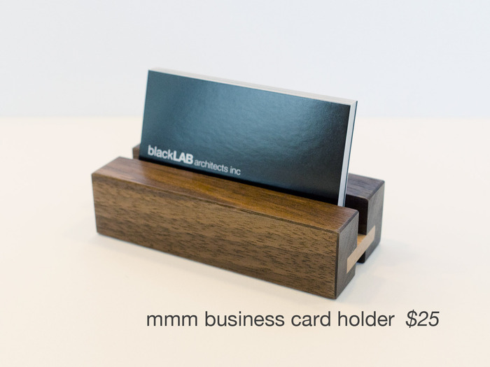 Add a touch of class to any desk with this solid walnut and maple business card holder.