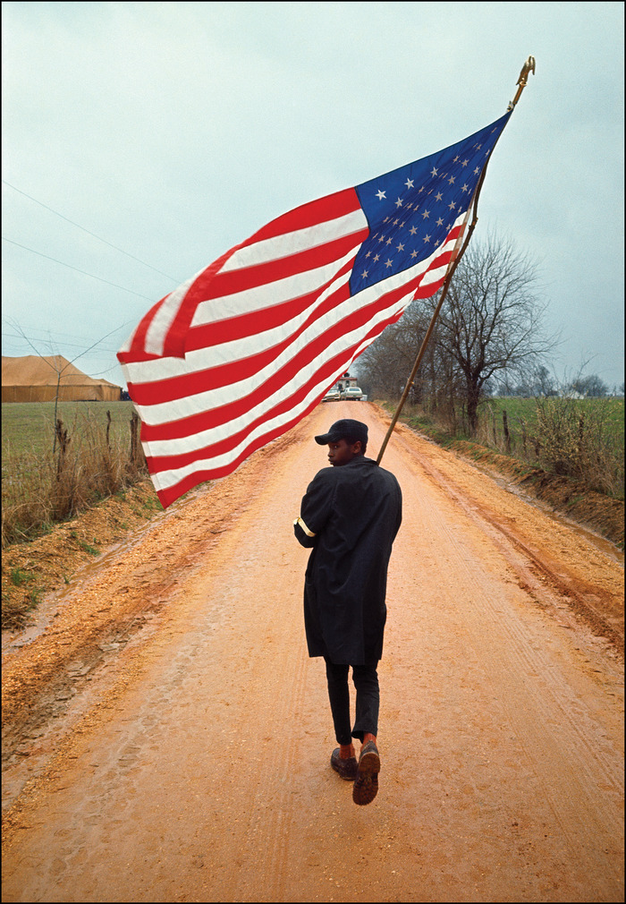 Henry Do-Right marching with the American Flag during the Selma to Montgomery March, 21 March 1965