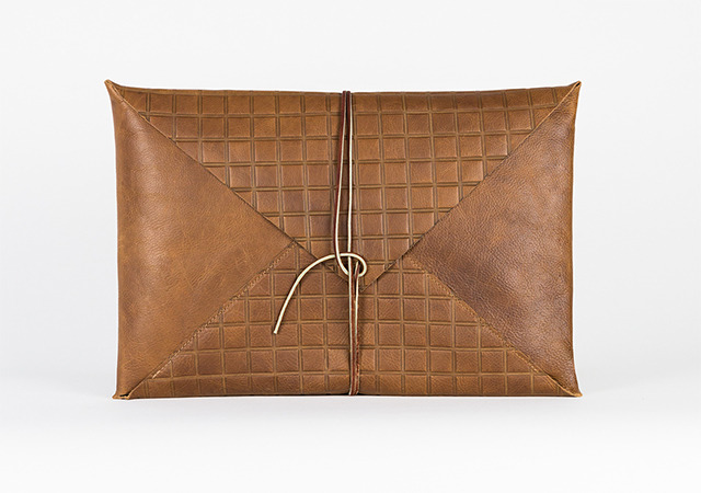 Newman Gridded laptop case available at stretch goal.