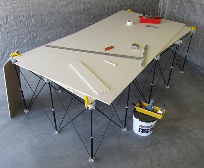 Measure, mark and cut drywall and other sheet materials