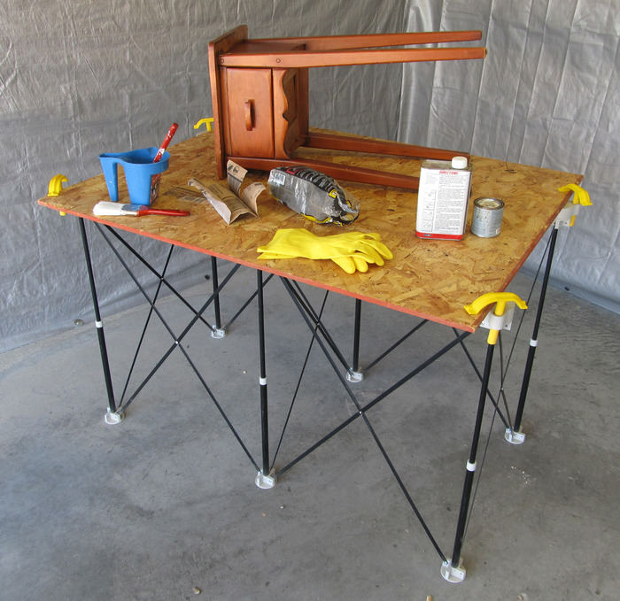 Spill paints and stains on scrap lumber instead of a workbench