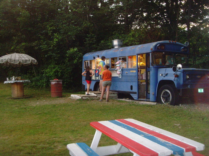 Patrons start gathering at the venerable Snack Bus as the drive-in opens for another night under the stars