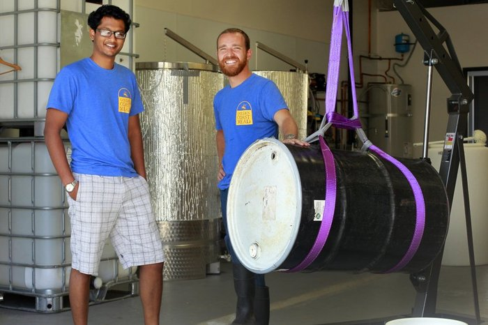 Praveen Ramineni, left, and Frank Golbeck wrestle a barrel of honey at Golden Coast's Oceanside meadery. — K.C. Alfred