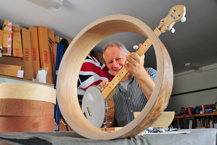 Simon Middleton with a prototype Shackleton banjo, with optional Oak & Birch rim in foreground.